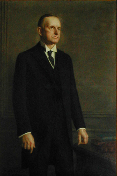 """This full size portrait of President Coolidge was painted by Ercole Cartotto. Although it is now at the Phi Gamma Delta's Headquarters, it was originally commissioned. by the Xi Graduate Chapter originally commissioned this for the Phi Gamma Delta Club in New York City. Ercole Cartotto's painting was dedicated on February 20, 1929, in the Club library. It is """"life size."""""""