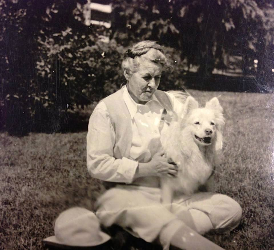 "Mary Love Collins at her cabin in Pennsylvania with her dog, ""Frolic,"" c 1932 (photo courtesy of Chi Omega Archives)"