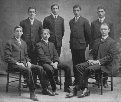 The Founders of Kappa Delta Rho. Back Row, l-t-r:  Benjamin E. Farr, Chester M Walch, Gideon R. Norton, and Gino A Ratti     Seated, L-t-r:  Thomas H. Bartley, George E. Kimball, and Roy D. Wood