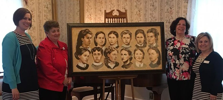 Four members of the Holt House Committee along with the painting of Pi Beta Phis 12 founders.